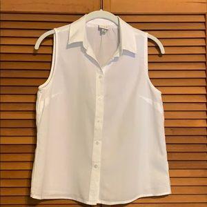 White sleeveless button down shirt.